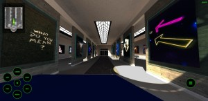 An art gallery like space with installations on walls throughout.
