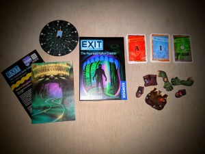 Exit The Game Haunted Roller Coaster box and assorted components.