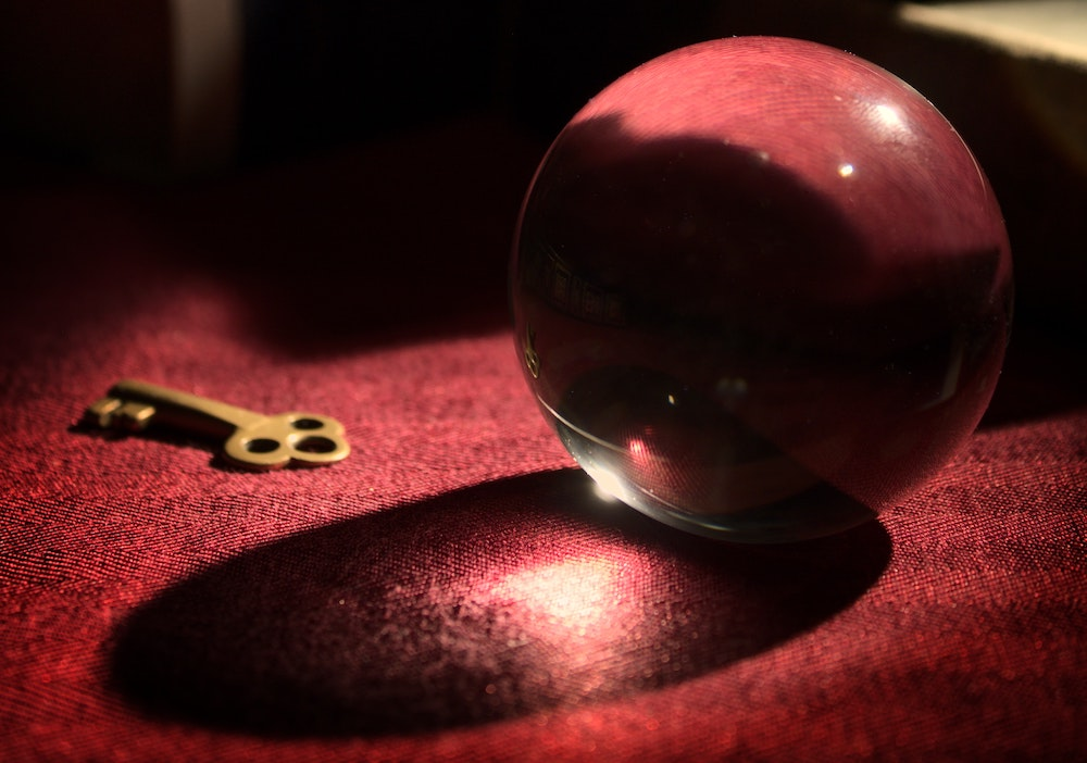 Crystal ball beside a key.