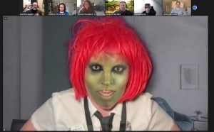 A lizard person on Zoom.