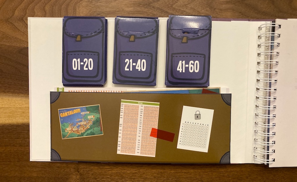 Cantaloop inside cover has a series of pouches, and an envelope, all loaded with game materials.