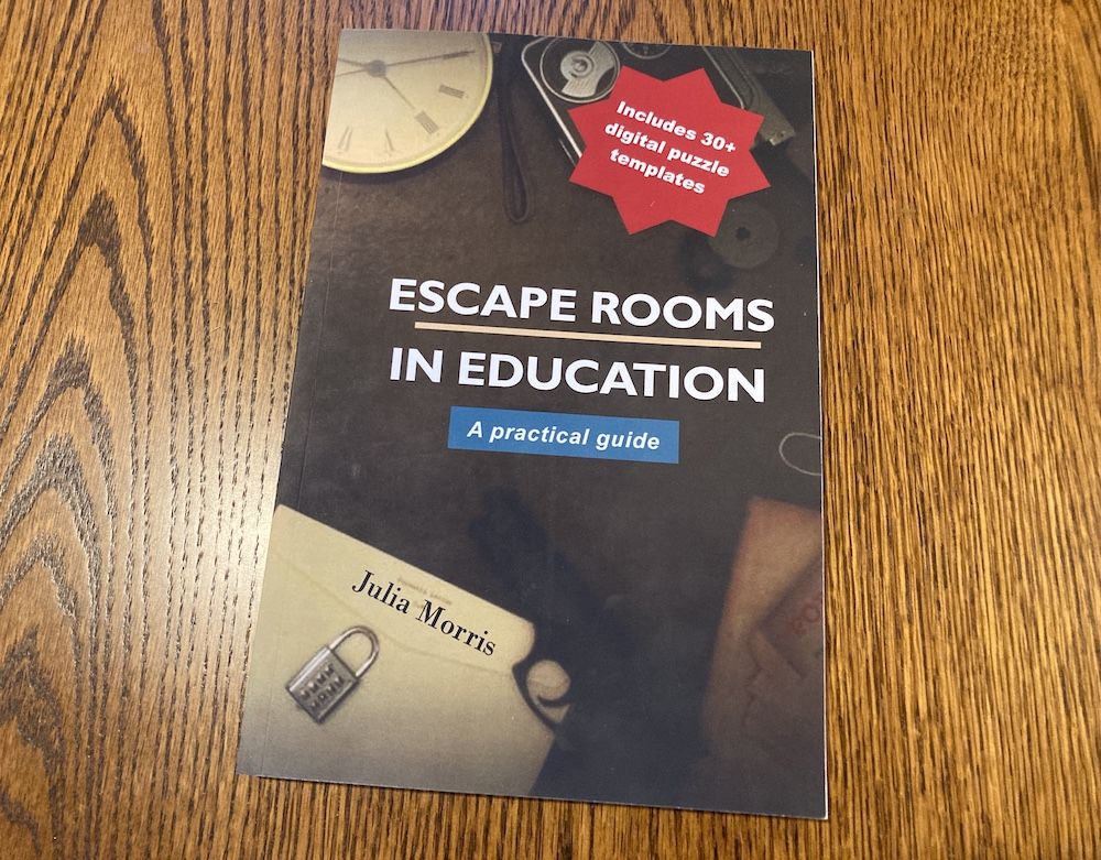"""Book cover for """"Escape Room in Education: A Practical Guide"""" has an assortment of locks and escape roomy items."""
