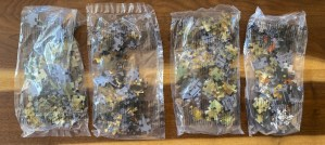 4 sealed bags of puzzle pieces.
