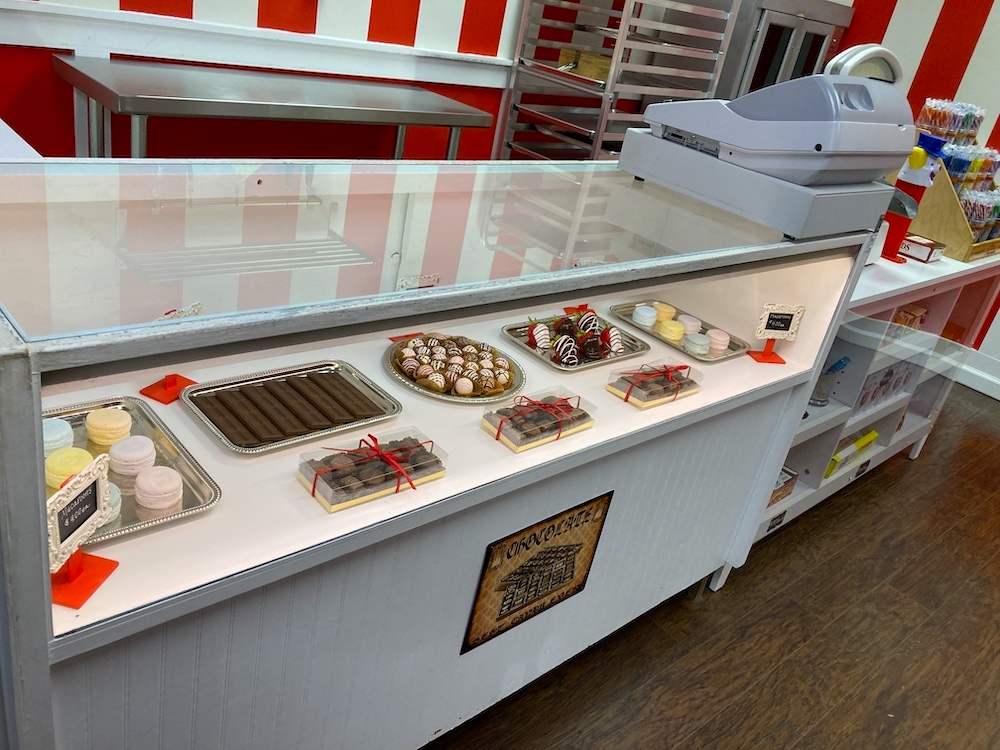 Closeup of the chocolate display in a candy shop.