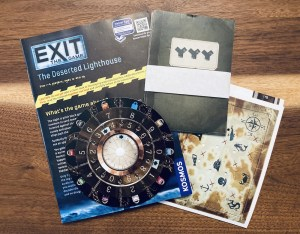 Assorted game components including a sea map, a solution wheel, and instructions.