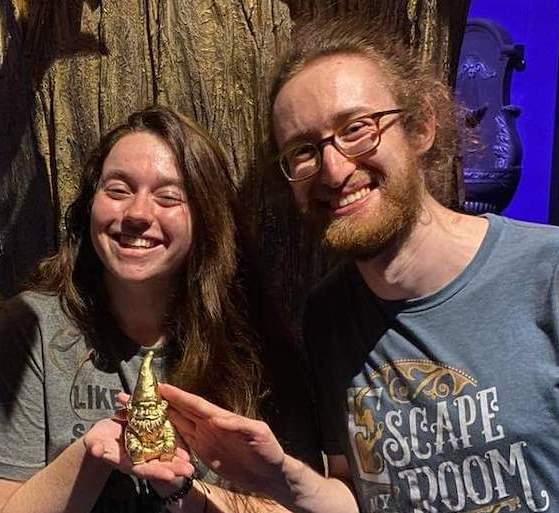 Matthew & Theresa holding their golden gnome.