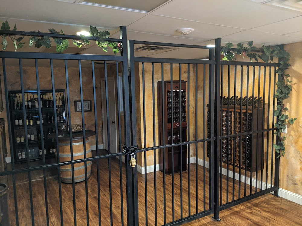 A wine cellar with a drop ceiling.