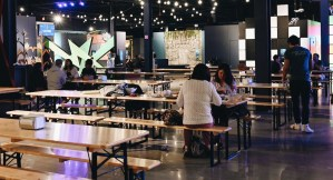 Many tables in the eatery area in the middle of Level 99.