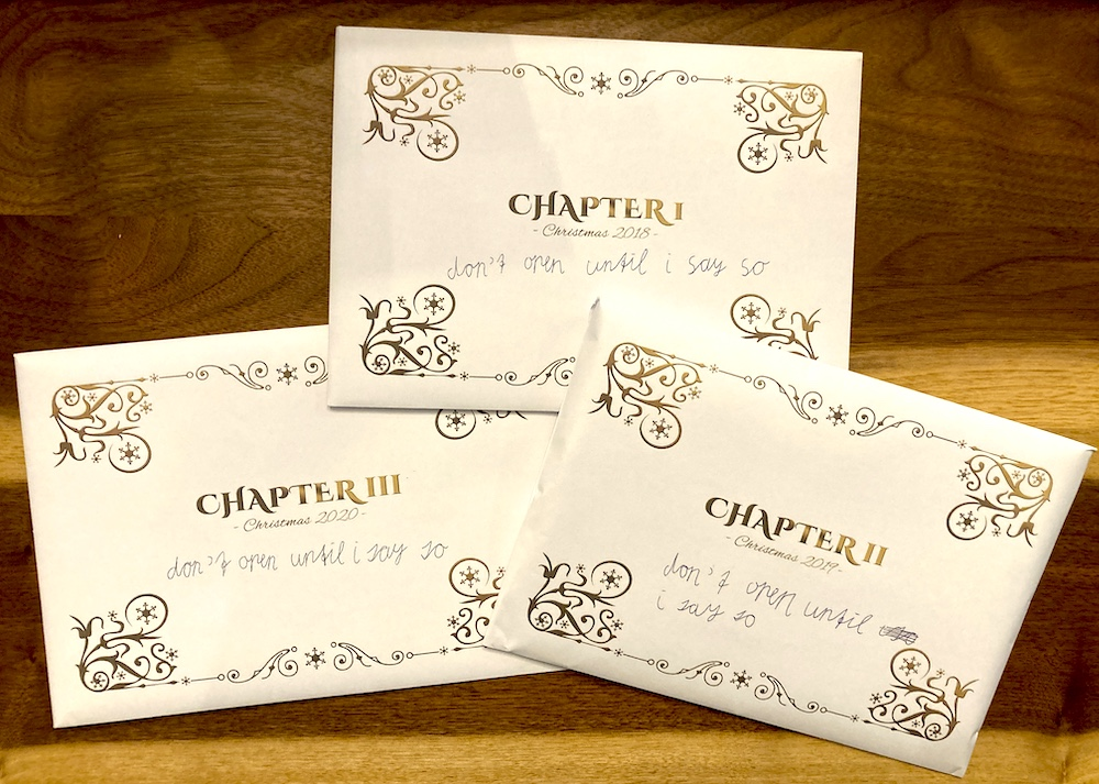 """3 chapter envelopes for Dear Santa. The typography looks regal and Christmas-y, with a child's cursive reading, """"Don't open until I say so."""""""
