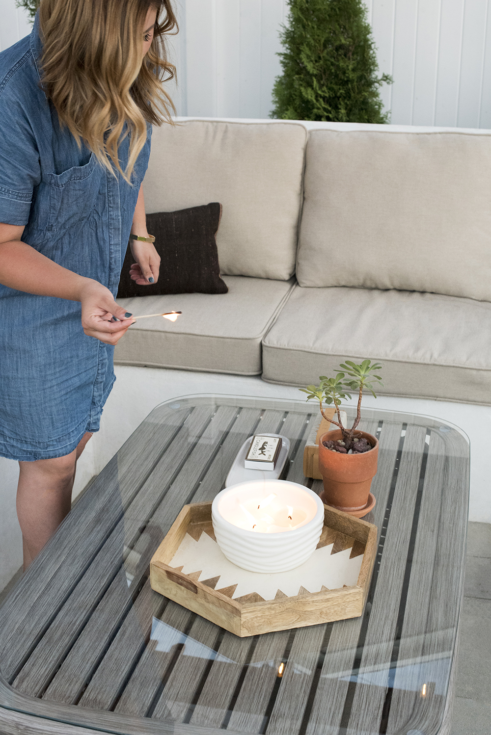 Lighting Candles on the Patio