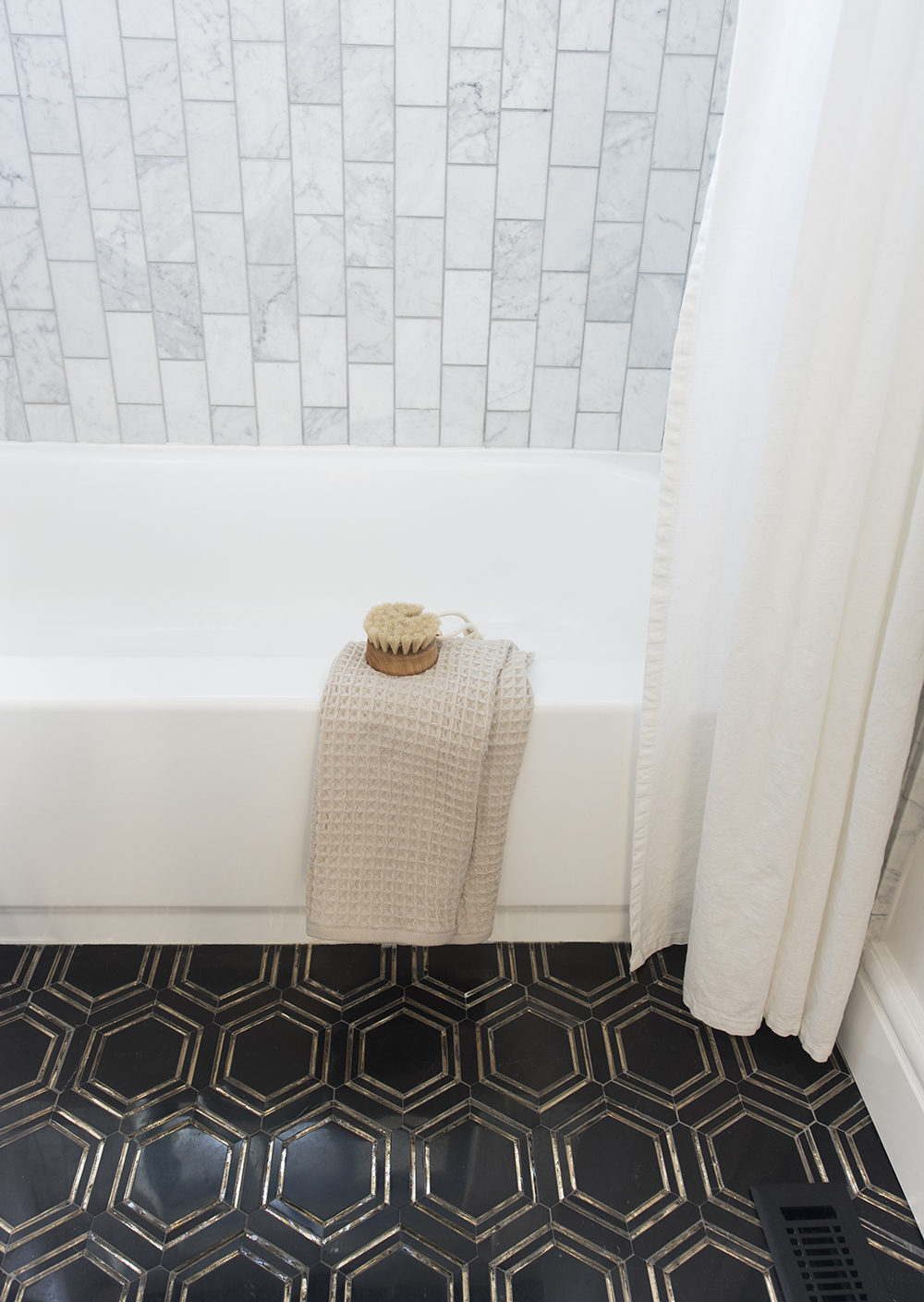 Marble Bathroom with Black and Gold Hex Floor Tile - Room For Tuesday