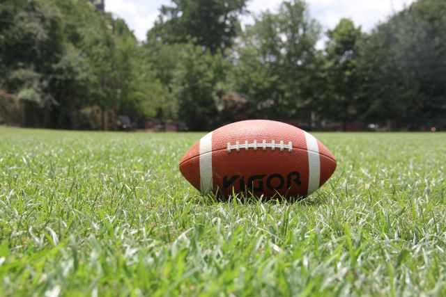 kigoa football on green grass during daytime