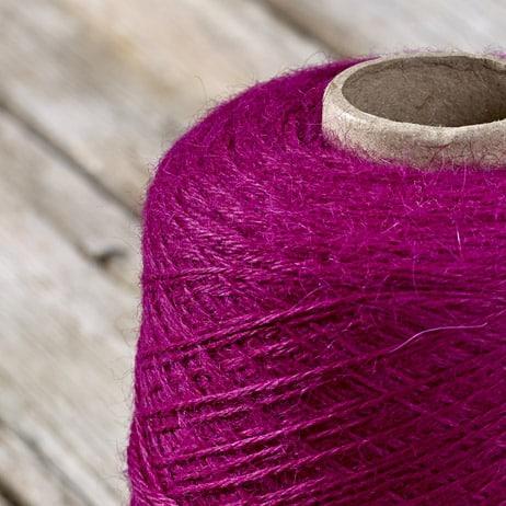 C220 Magenta coloured cone yarn
