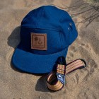 The Rooted Ocean Dad Pack in the sand