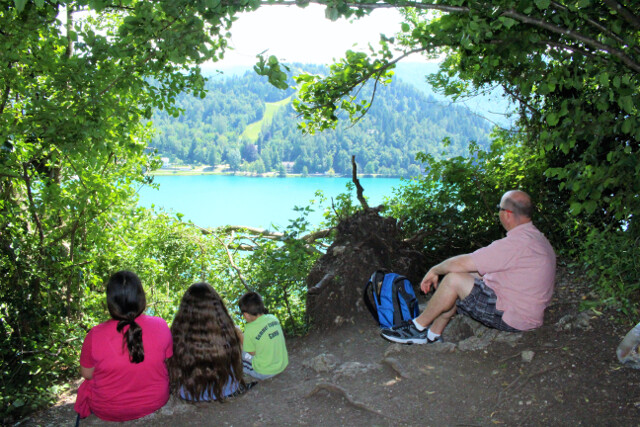 Picnicking on the hillside overlooking Lake Bled in Slovenia. $5 for fresh baguettes, some ham, salami, prosciutto, and cheese equals a nice little feast with a view.