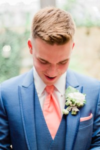 wedding at soserene, soserene wedding, white and blush wedding, boutonniere, groom
