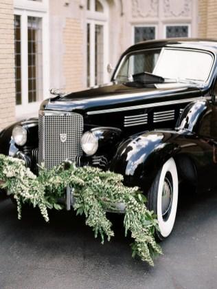 black getaway car with a spirea garland