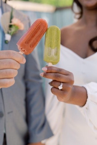 african american couple does the cheers motion with the colored popsicle at mojave east in cincinnati