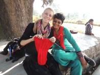 Eva learns to knit from Radha, a Jagori team member.