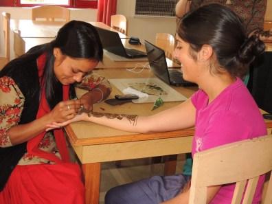 Manju creates an incredible mehndi design on Clarke's arm for Diwali.