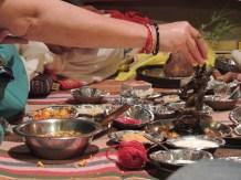 Maya blesses and feeds Ganesh.