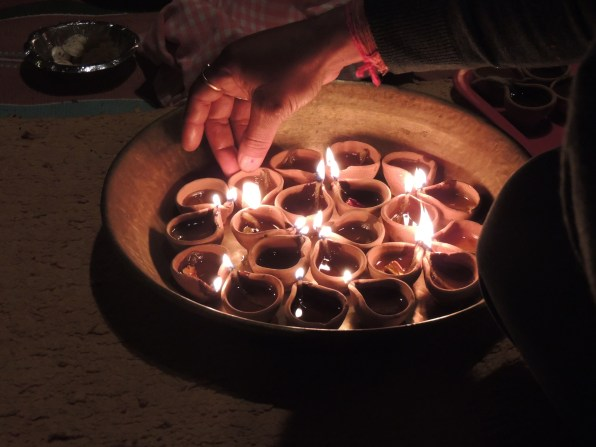 Diwali lamps being lit.