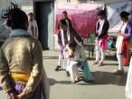 Vandana (standing) says to Bhavna (crouching) - I am with you!