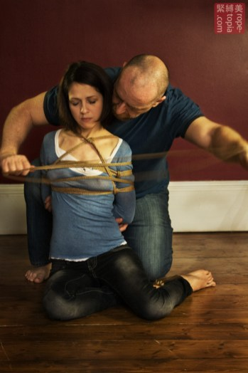 Nina Russ surrendering to rope bondage by WykD Dave. Photograph by Clover