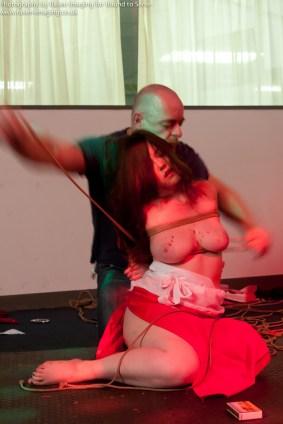 Untying Clover from shibari bondage session. Hot wax.