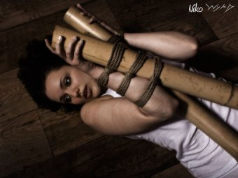 Scared and bound to Bamboo in shibari bondage