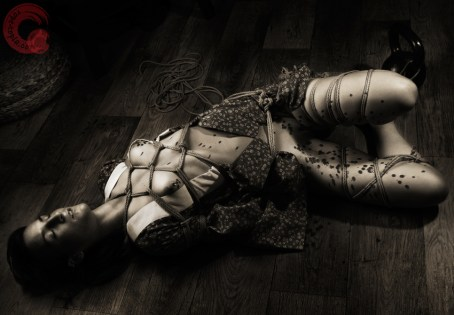 Floor bondage after rope torture.
