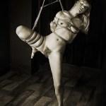 Shibari bondage partial suspension.