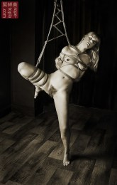 Shibari bondage partial suspension.