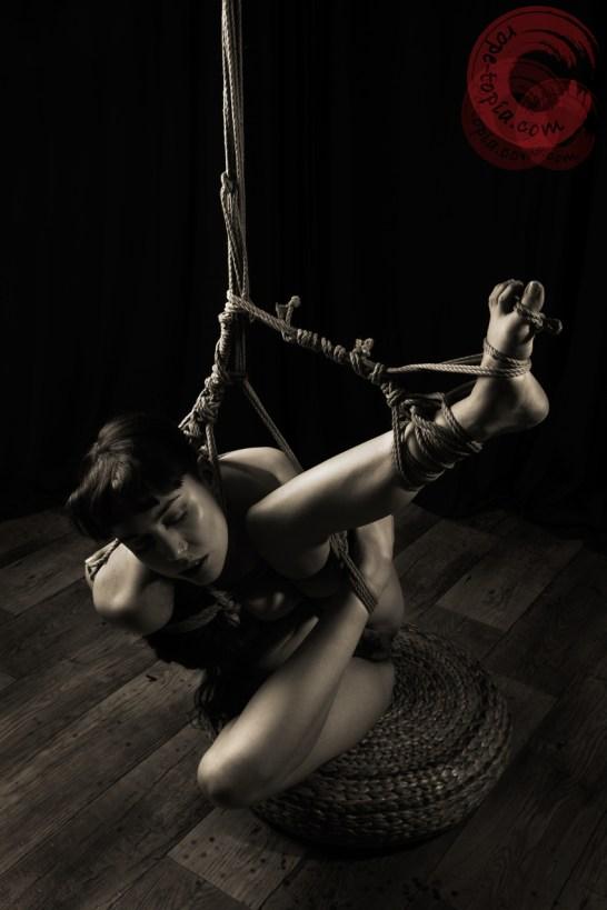 Twisted model shibari partial suspension