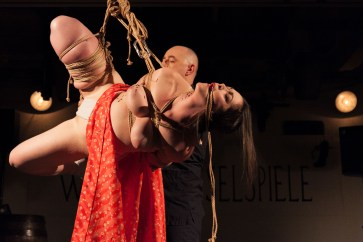 Shibari suspension performance, Vienna Rope Festival. Reverse prayer hands 後手 合掌 縛り - Gote Gasshou Shibari