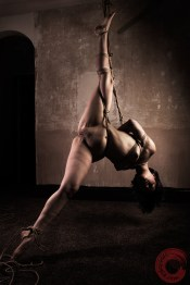 Stretched in harsh shibari suspension bondage