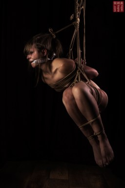 Shibari suspension bondage gagged and bound