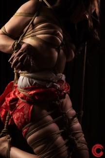 Raggydoll Kinbaku bound hands, breast bondage, leg bondage