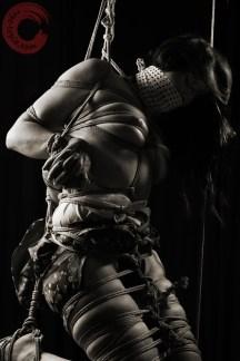 Gagged and bound, shibari kimono bondage, bound hands brests and thighs.
