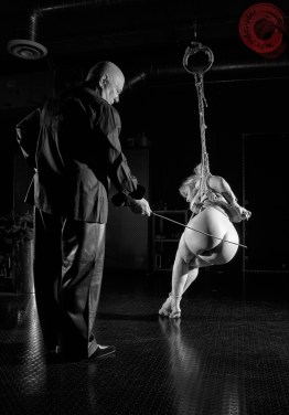 Nina Hartley in Shibari bondage partial suspension. Caning by Ernest Greene. Image Clover, Rope by WykD Dave #WykDRope