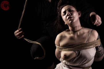 Sophia Shibari being tied in rope bondage