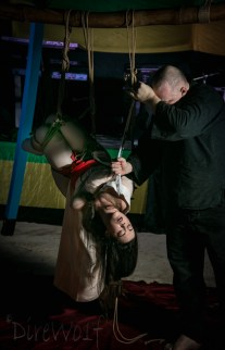 Waterboarding Clover during intense shibari bondage show at Beach Bind in Jamaica