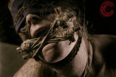 Tongue bondage, tongue tied and blindfold. Harsh neck rope.