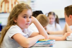 Young girl at school looking bored and sad