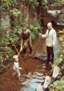 1983 Fleischmann at work on the stream with grandson Max, son-in-law Rainer Würgau
