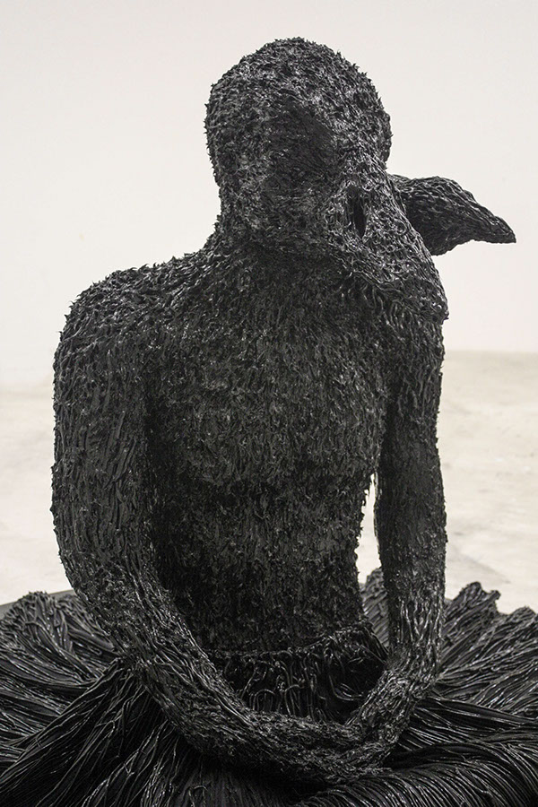artist rook floro anxiety sculpture.seated