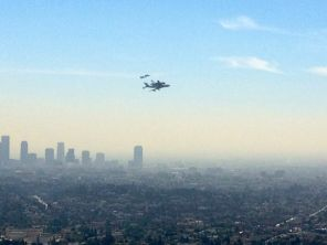 shuttle flying over Los Angeles with fighter jet escort. Photo credit Trudy.