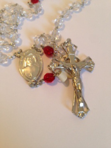 Sister Faustina is shown on the center medal of this rosary.