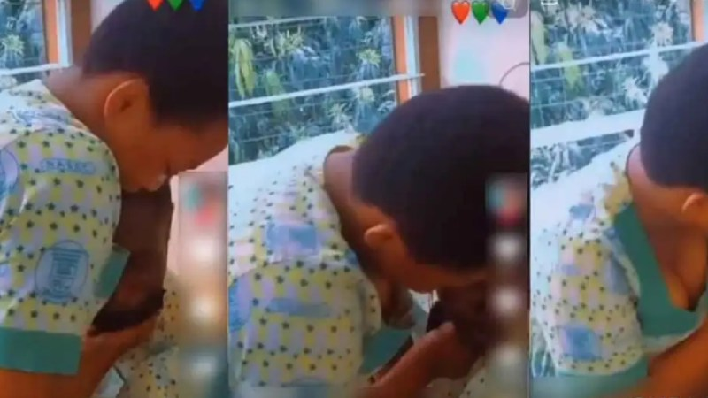 Female secondary school student caught on camera forcing her male classmate to kiss her during school hours (video)