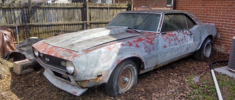 sell my car - old camaro behind a house